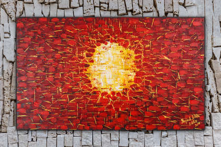 Birth, Abstract oil painting on canvas painted by Attila Hajnal, hanging on stone wall background