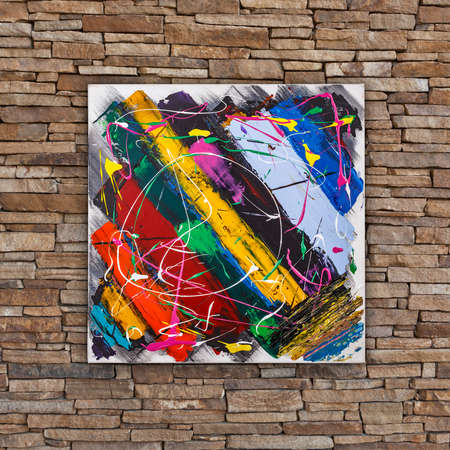 Abstract colorful oil painting, brush stripes and splashes, painted by Attila Hajnal, hanging on stone wall