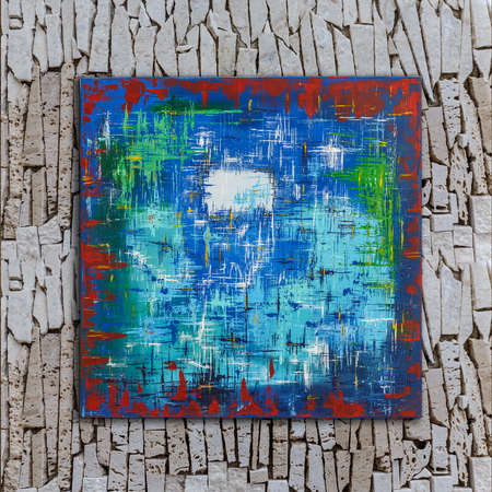 Abstract colorful oil painting on canvas painted by Attila Hajnal, hanging on stone wall Stock fotó