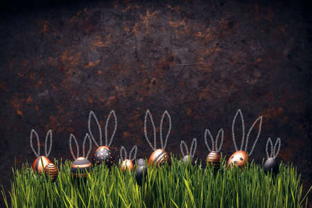 Set of stylish eggs with Easter bunny ears on green grass against grungy dark background, space for text