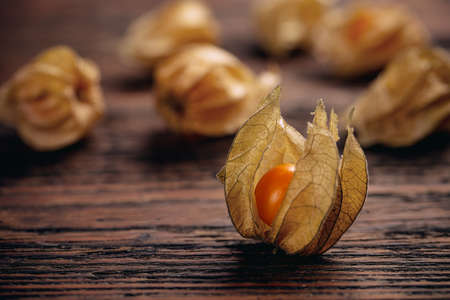 Close up of Cape gooseberry or Physalis on vintage wooden surface