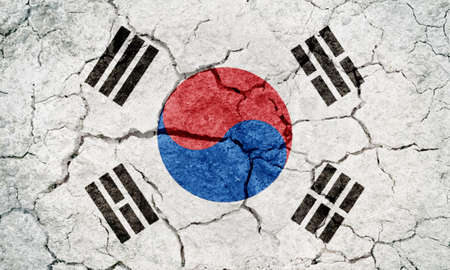 Republic of Korea flag on dry earth ground texture background Imagens - 120264663
