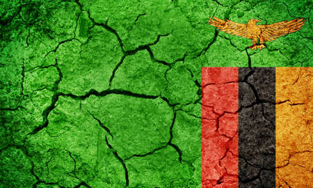 Republic of Zambia flag on dry earth ground texture background