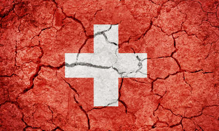 Swiss Confederation flag on dry earth ground texture background 版權商用圖片