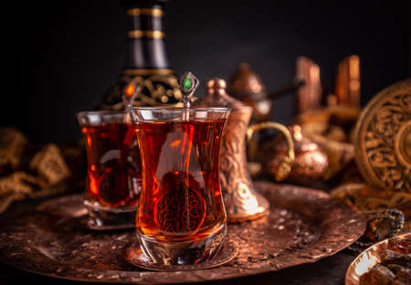 Black Turkish tea in traditional glass on tray Reklamní fotografie