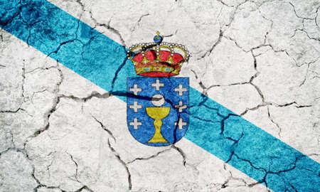 Bandiera della Galizia, comunità autonoma della Spagna, su fondo di struttura al suolo di terra asciutta