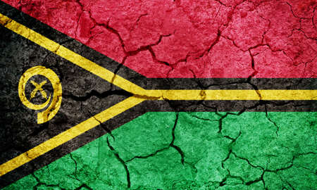 Republic of Vanuatu flag on dry earth ground texture background