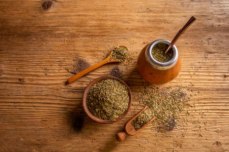 Traditional South American yerba mate leaves and tea served in the calabash with bombilla