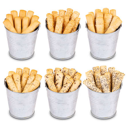 Different kind of crispy bread sticks in metal bowl on white background Stock Photo