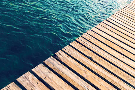 Swimming pool and wooden deck ideal for background, copy space