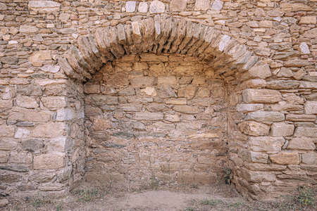 Walled-up archway in a stone wall background