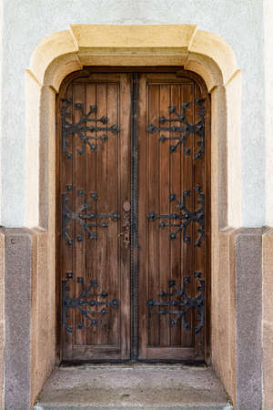 Entrance door of an building with elegant wrought iron decorations