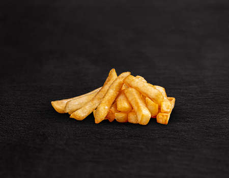 Pile of french fries on black background Stockfoto