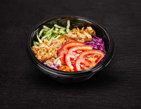 Fresh salad with chicken breast, red cabbage, cucumber and tomato