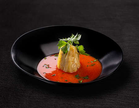 Transylvanian stuffed bell pepper soup seasoned with celery leaf