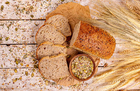 Top view of bread with different seeds, pumpkin, poppy, flax, sunflower, sesame Imagens