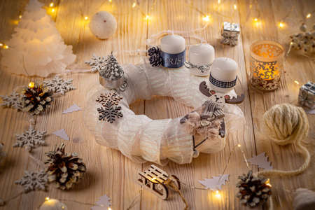 White advent wreath with decoration on wooden background Stock Photo
