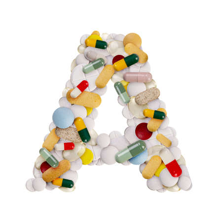 Capital letter A made of various colorful pills, capsules and tablets on isolated white background