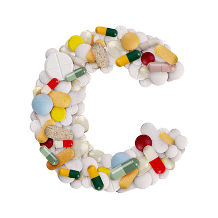 Capital letter C made of various colorful pills, capsules and tablets on isolated white background Banco de Imagens