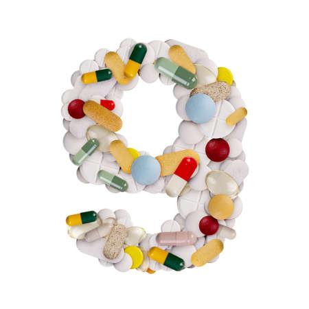 Number 9 made of pills Zdjęcie Seryjne