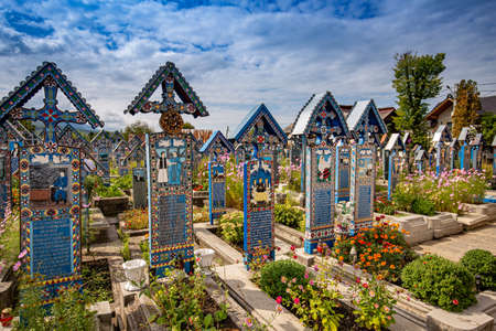 SAPANTA, ROMANIA - AUGUST 10, 2015 - Painted wooden crosses in the famous Merry Cemetery in Maramures