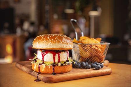 Vegetarian burger with camembert