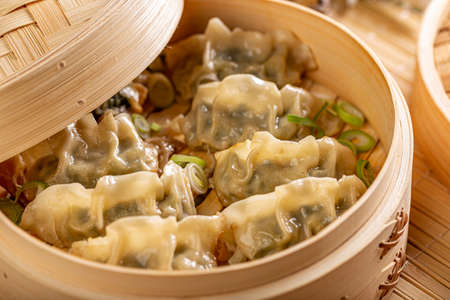 Asian dumplings in bamboo steamer. Traditional Chinese cuisine