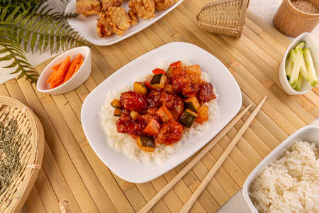 Chicken on sweet and sour sauce Stockfoto