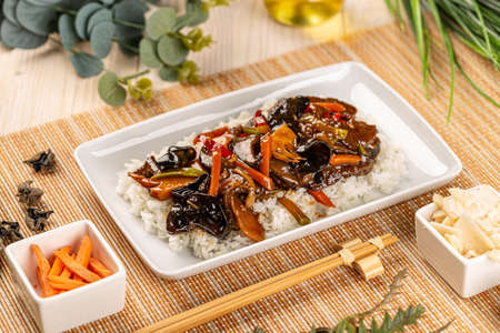 Chinese style menu, stir fry vegetables with shiitake and bamboo shoots served with boiled rice