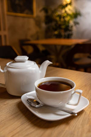 Hot tea and teapot served on the restaurant table