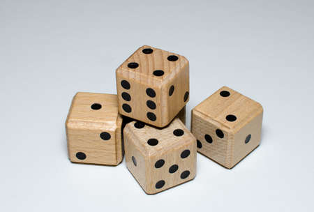 pile of four wooden dice Stock Photo