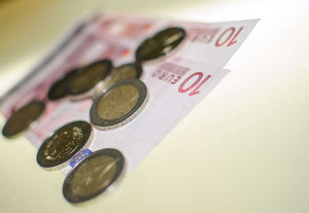 detail of euro coins and notes Stock Photo