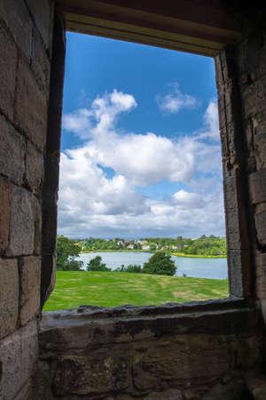 pane: View through a stone framed window