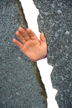 Hand between two stone walls Stock Photo - 27574608