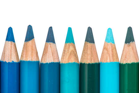 distinction: Row with Blue and Green Colored Crayons