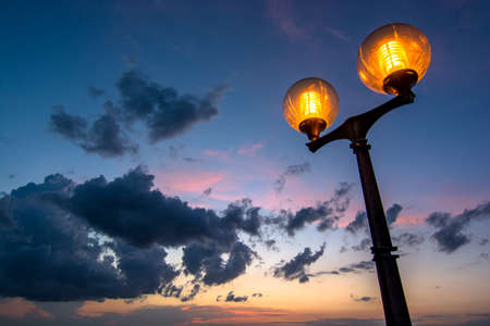 Scenic Streetlamp with Cloudy Night Sky Stock Photo