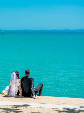 bridal couple: Bridal Couple Sitting On Lake