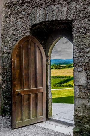 Open Heavy Door With View To Irish Landscape Stock Photo