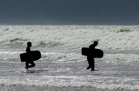 boarders: Two Body Boarders Entering Water