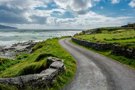 narrow street: Narrow Coastal Road in Ireland Stock Photo
