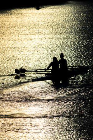 synchronous: Female Rowers on Sunset Lake