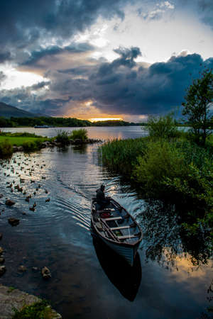 lough: Boat returning from Lough Leane in Killarney National Park in Ireland