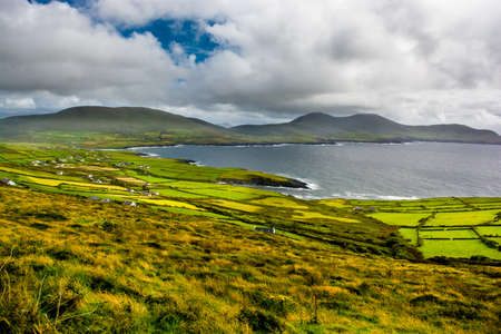 Landscape with Houses and Coast in Ireland Stock Photo