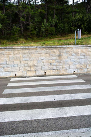 Crosswalk with Dead End at Stone Wall Stock Photo