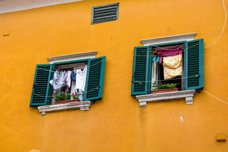 Laundry To Dry in Opened Window Stock Photo