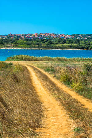 Settlement on Hill at the Coast of Istria in Croatia Stock Photo