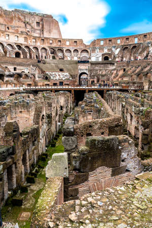 ROME, ITALY - FEBRUARY 6, 2018: Interior view of the Flavian Amphitheatre, Colosseum. The monument is a symbol of Imperial Rome and one of the most popular tourist attractions in the city