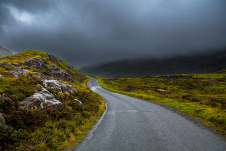 Scenic Single Track Road Through Hills On Isle Of Skye In Scotland
