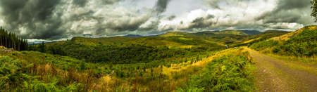 Scenic Landscape With Green Valley And Cloudy Sky In Scotland