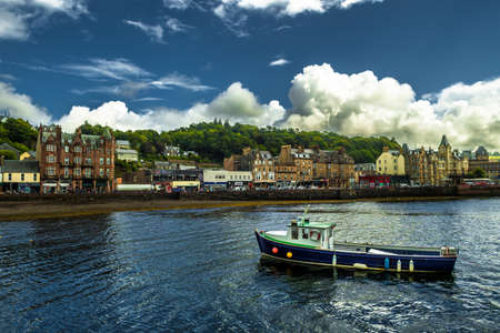 Vivid City Oban With Colorful Houses And Boats In Scotland